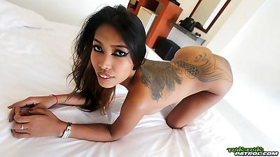 Hot Asian slut strips naked..