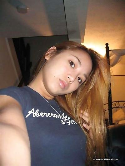 Hot ass asian babe posing..