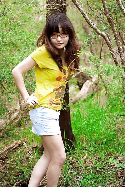 Petite Asian girl in glasses..