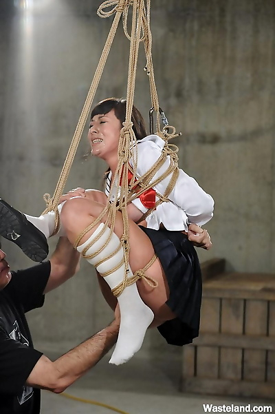 Asian female is suspended by..