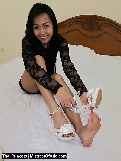 Spoiled Thai Princess models her sexy feet in all her new high heel shoes