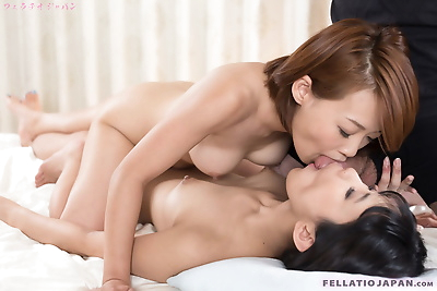Japanese girls spit cum into each others mouths after a double blowjob