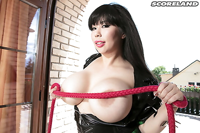Chubby Asian woman Tigerr Benson with massive juggs bared in thigh high boots